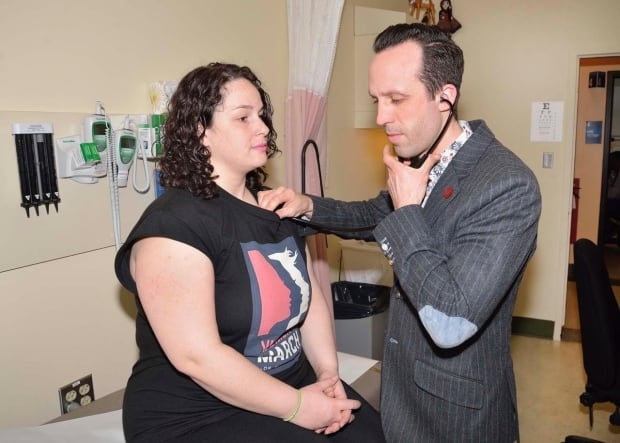 Sean Wilson examines patient