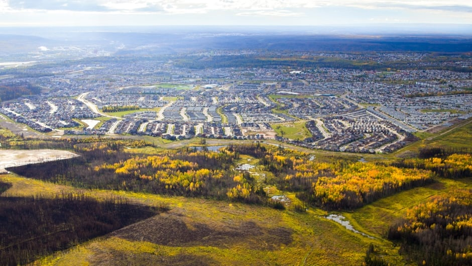 This September, 2016 photo looking over the northern end of Fort McMurray shows the mixed severity of the fire and the live trees next to the community.