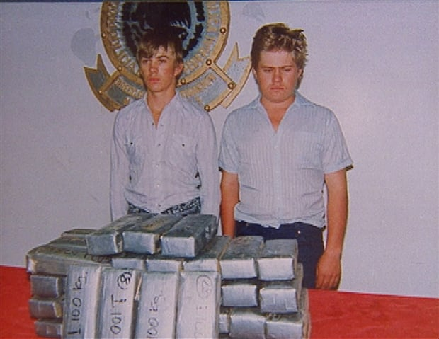 Brothers Jake, left, and Enrique Harms stand in front of the marijuana they were arrested for trafficking in Mexico in the early 1990s