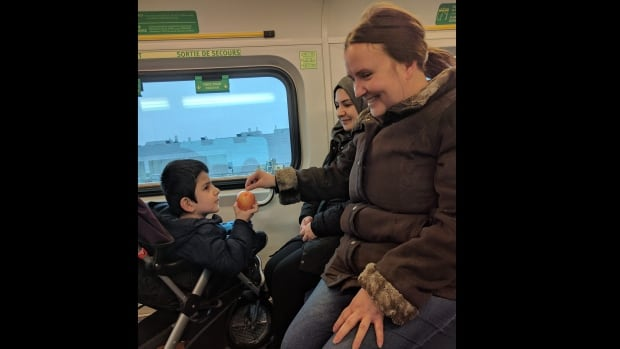A Good Samaritan gave Abdulaziz Shoev, 5, an apple after the little boy became hungry on the delayed GO train. He and his mother, Shirin Ziyovuddinova, were travelling to Sick Kids to see a specialist.