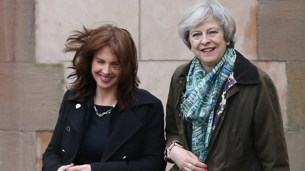 British Prime Minister Theresa May is seen here with her Conservative Party candidate Trudy Harrison, left, who won the byelection in Copeland on Thursday, February 23, 2017. The northwest England constituency had been held by the Labour Party since 1935.