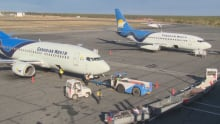 Canadian North planes being emptied of luggage at the Yellowknife airport