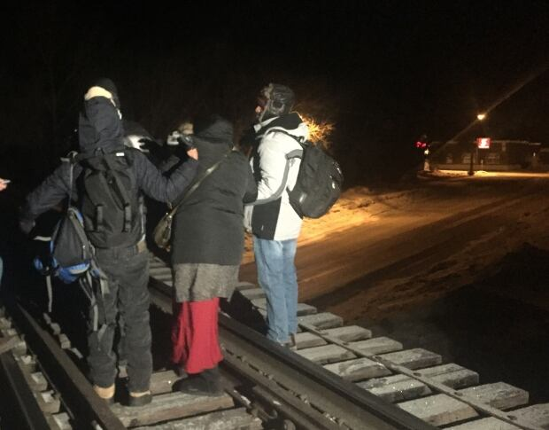 Seven more refugees walked for hours to cross the Canada-U.S. border into Manitoba early Sunday.