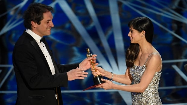 Sofia Boutella, right, presents Sylvain Bellemare with the award for best sound editing for Arrival at the Oscars on Sunday night at the Dolby Theatre in Los Angeles.