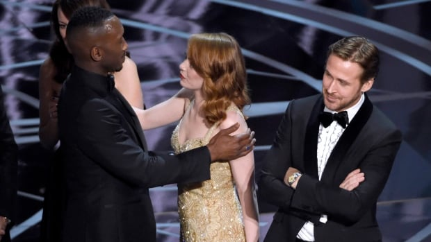 Emma Stone, centre, congratulates Mahershala Ali as Moonlight is announced as the true Oscar winner for best picture, minutes after La La Land was initially and incorrectly named. A bemused Ryan Gosling stands to the right. The Academy of Motion Picture Arts and Sciences and accounting firm PwC have apologized for the epic mix-up.