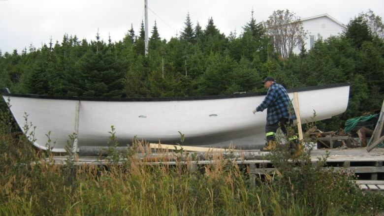 One of the last st lewis boat builder to retire from trade at 71 curl 71 starts the boat building process by going out into the woods and cutting down trees submitted malvernweather Image collections