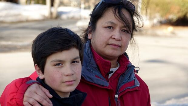 Arlene Seletaria-Childs is talking to her Grade 6 son Erin about making the switch to a Catholic school out of frustration that J.H. Putman Public School could close.