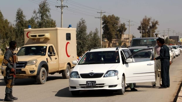 Afghan security officials check vehicles at the checkpost in Helmand, Afghanistan, 28 February 2017. According to media reports 11 policemen were killed after their own colleague opened fire on them at a checkposint in Lashkar Gah on 27 February before fleeing with members of Taliban.