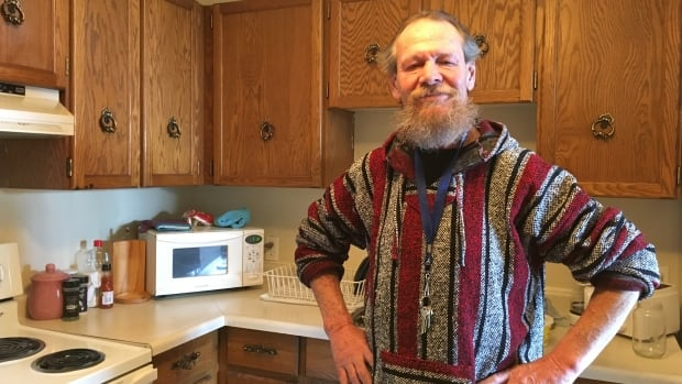 Bob Kastrukoff has had a few run-ins with police during his years on the streets in downtown Regina. Now he has a home and has welcomed officers inside for a visit.
