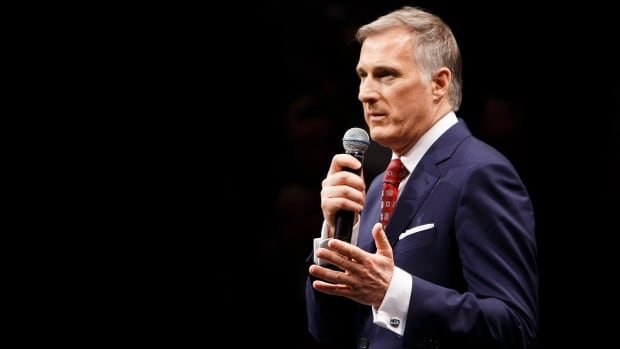 Maxime Bernier speaks during a Conservative leadership debate in Edmonton back in February. The front-runner has promised to go further than his rivals when it comes to cutting taxes and government spending.