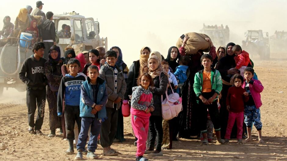 Syrian women and children travel from areas controlled by jihadists of the Islamic State (IS) group, en route to safety in areas held by by Kurdish-Arab Syrian Democratic Forces (SDF) alliance, on November 9, 2016.