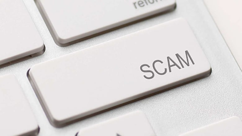 An Alberta woman who lost $75,000 in a binary options scam said she is  still too ashamed to tell her family what happened. (CBC)