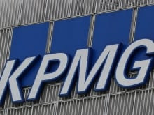 The KPMG logo is seen at their offices at Canary Wharf financial district in London