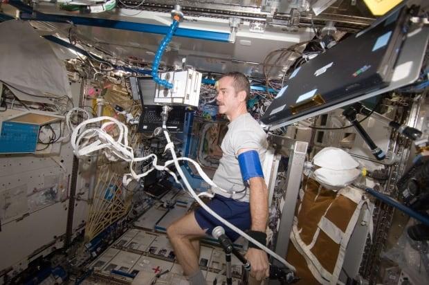 Hadfield ISS exercise