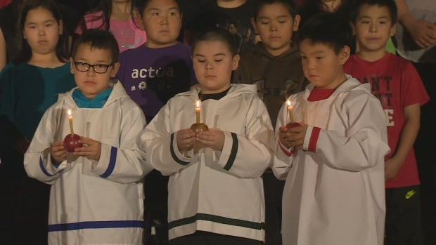 Children in Nain celebrate at a school pageant. Critics of sending children out of Labrador for foster care worry culture and language suffer as a result.