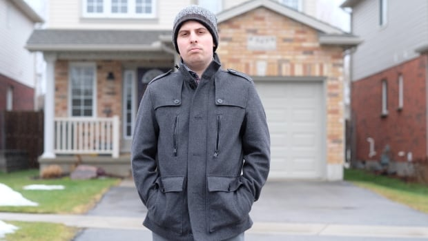 Christian McCrave, 21, stands in front of his parents' house in London, Ont. He moved back in when he couldn't find a job after graduating with a degree in mechanical engineering.