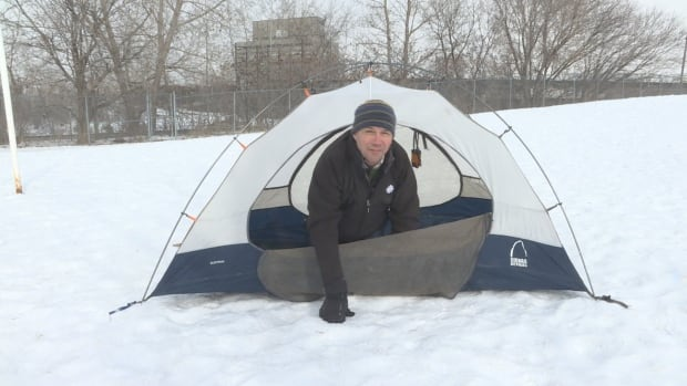 CBC Ottawa's Steve Fischer sets up a tent at Tom Brown Arena — about four months too early for Canada Day camping.