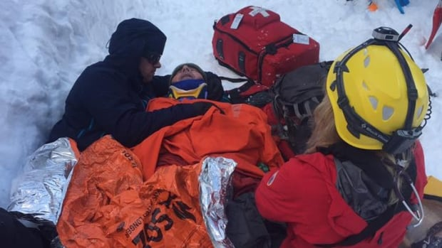 Volunteers with North Shore Rescue attend to a man rescued from an avalanche that spilled more than 120 metres down Hollyburn Mountain in Cypress Provincial Park on Saturday, March 4, 2017, burying the victim for five minutes in six feet of snow.