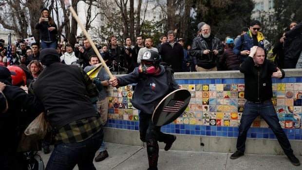 A demonstrator in support of U.S. President Donald Trump swings a stick toward a group of counter-protesters during a rally in Berkeley, Calif., on Saturday.