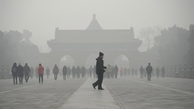 Heavy smog is seen at the Temple of Heaven park in Beijing on Dec. 20, 2016, when low-visibility conditions forced flight cancellations and caused road and rail transport to grind to a halt.