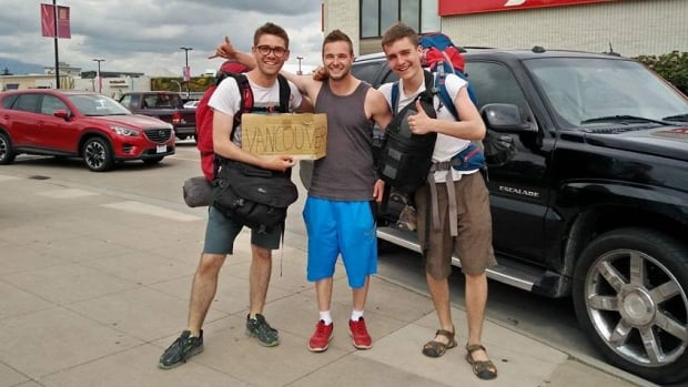 Jonah Haber (left) and Jackson Peters (right) celebrate their arrival in Vancouver last year with Tyce (centre), their 26th driver since Halifax.
