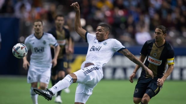 Vancouver Whitecaps' Christian Dean, centre, takes a shot in front of Philadelphia Union's Alejandro Bedoya during a scoreless draw in Vancouver on Sunday.
