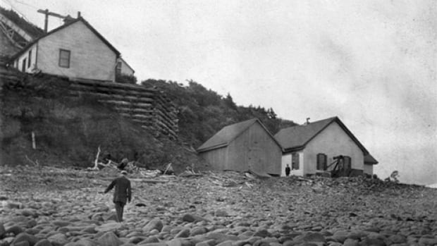 The 1874 fog alarm building at Long Eddy Point on Grand Manan sits atop the beach, with the 1905 version below.