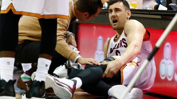 Andrew Bogut grabs his leg after breaking it during his first appearance with the Cleveland Cavaliers Monday.
