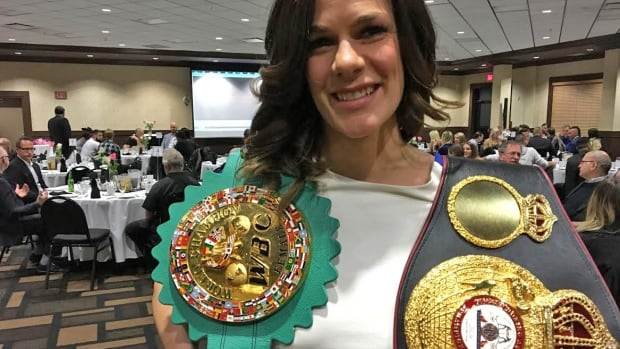 Jelena Mrdjenovich, pictured with her World Boxing Commission and World Boxing Association belts, was named the Edmonton Combative Sports Commission's 2016 International Boxer of the Year Monday night at the Chateau Nova Yellowhead.