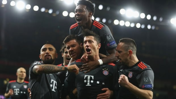 Robert Lewandowski, second from right, and Bayern Munich teammates celebrate his penalty-shot goal against Arsenal Tuesday in second-leg Champions League action.