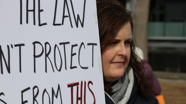 A protester at a March 7 rally in Halifax calling for an inquiry into the actions of Judge Gregory Lenehan. Lenehan acquitted a cab driver of sexual assault in a controversial decision. Kimlee Wong says the courts need to do a better job of helping to prevent violence against women.