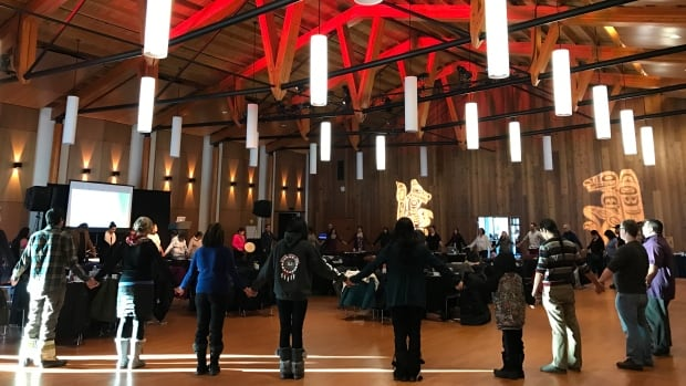 Participants at the 'Voice for Change' gathering share an early morning prayer at the Kwanlin Dün Cultural Centre in Whitehorse.
