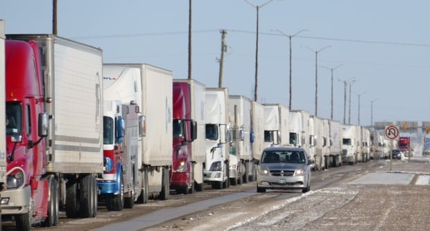 Stranded semis wait on highway near Brandon after snowstorm