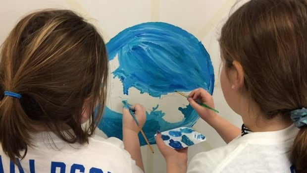 Children from the Charlottetown Boys and Girls Club work the mural that will be displayed in the Toronto subway system.