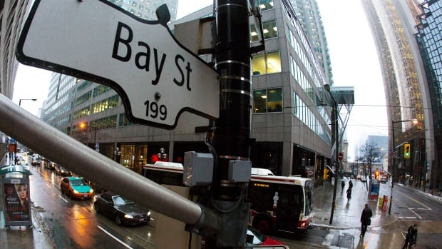 Canada's central bank is holding interest rates firm. But the downgrades by ratings agencies of Canada's Big Six banks, symbolized by Toronto's financial hub Bay Street, have the effect of making Canadian consumer borrowing more expensive.