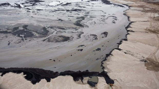 A Shell tailings pond at their tar sands operations near Fort McMurray, Alberta, September 17, 2014. The government has provided a response to a call from the environmental arm of NAFTA to explain what Canada is doing to stop oilsands tailings ponds from leaking into Alberta waterways.
