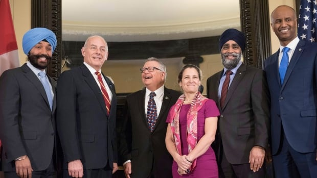 Left to right: Innovation Minister Navdeep Bains, U.S. Secretary of Homeland Security John Kelly, Public Safety Minister Ralph Goodale, Foreign Affairs Minister Chrystia Freeland, Defence Minister Harjit Sajjan and Immigration Minister Ahmed Hussen, pose for a photo on Parliament Hill on Friday.