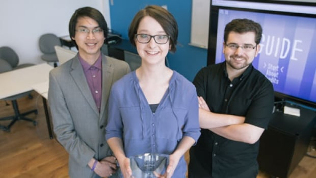 UNB students Jade Yhap (left), Rebecca Goodine (center) and Elliot Coy (right) developed a video game that they hope will help children suffering from social anxiety.