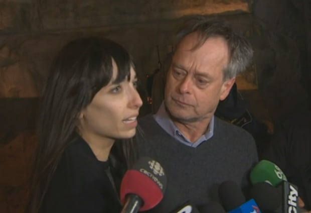Jodie Emery and Marc Emery emerge from court