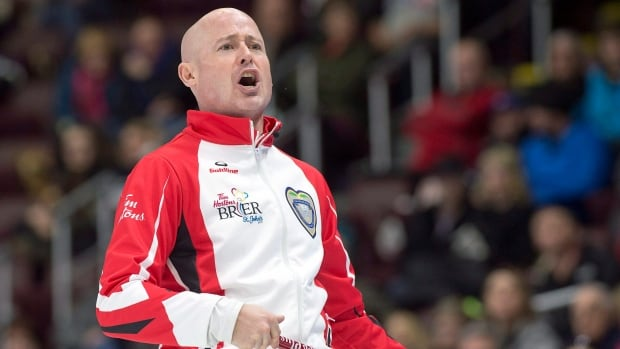 Team Canada skip Kevin Koe reacts to a rock as they play Northern Ontario's Brad Jacobs.