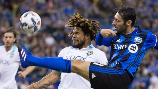 Matteo Mancosu, right, of the Impact challenges Sounders FC's Roman Torres during Montreal's 2-2 draw in home opener against Seattle on Saturday.