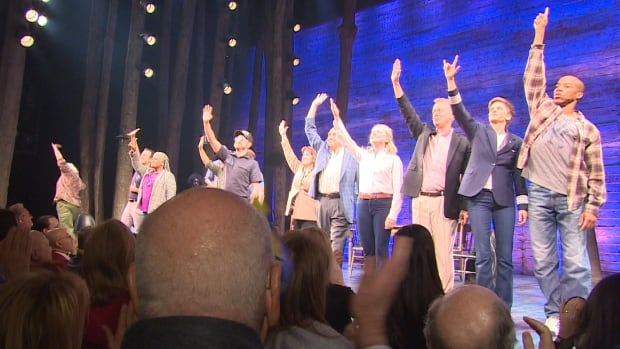 The cast of Come From Away take a bow towards a standing audience at the Gerald Schoenfeld Theatre on opening night.
