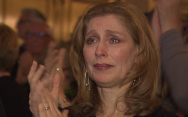 Woman crying at finale of Come From Away