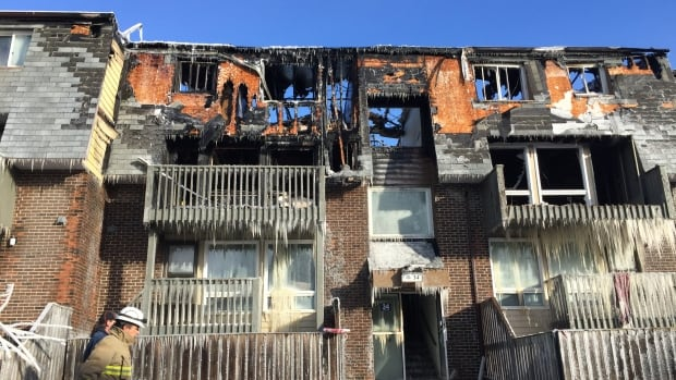 Ottawa fire officials say up to 75 people have been displaced after flames ripped through a row house complex on Northview Road Sunday.