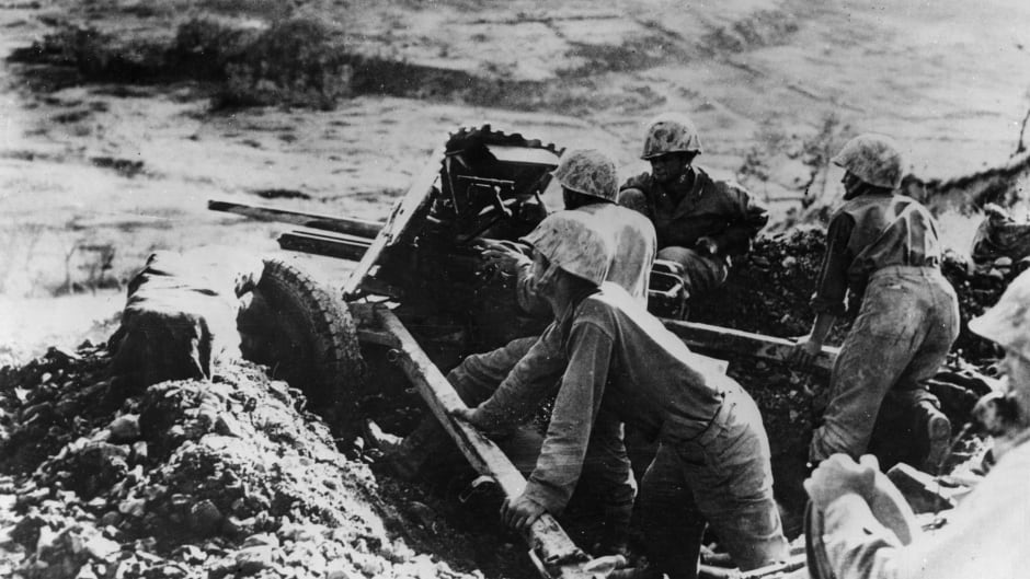 On the slope of a hill on Okinawa, Japan, on June 8, 1945, a machine-gun crew takes on Japanese forces.