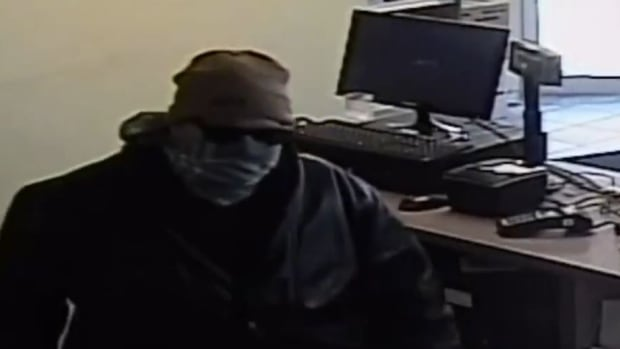Windsor police are investigating after a suspect with a scarf wrapped around his face entered a pharmacy and stole drugs Sunday afternoon.