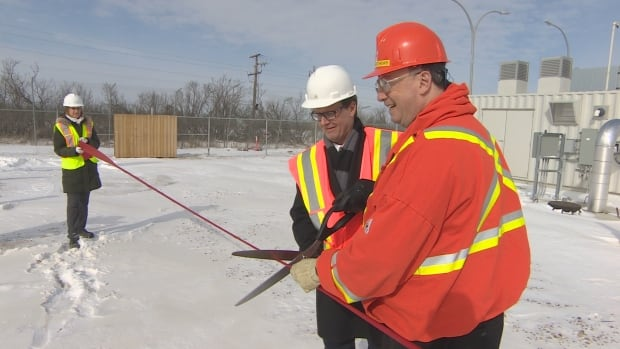 Mayor Michael Fougere and Howard Matthews, vice president of power production at SaskPower, cut the ribbon for the Landfill Gas to Energy Facility Monday morning.