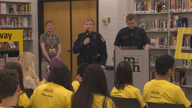 Const. Amanda Trenchard speaks to McNally High School students about coaching Special Olympians.