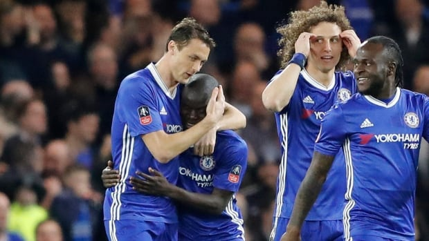Chelsea players celebrate after N'Golo Kante, second from left, scored the opening goal during the FA Cup quarter-final match against Manchester United.
