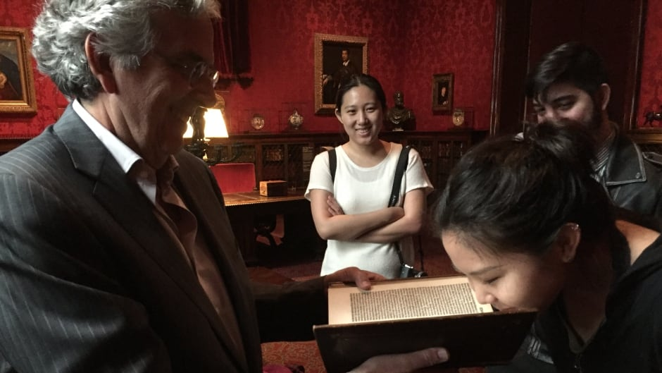 Columbia students with Carlos Benaim (Master Perfumer, International Flavors & Fragrances), smelling a 16th century book at the Morgan Library & Museum.